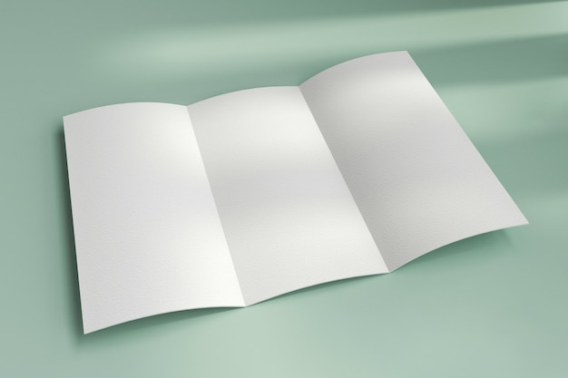 Top view on blank white paper trifold brochure