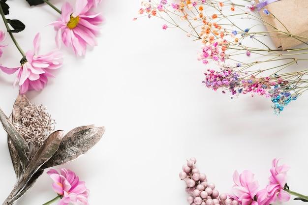 Top view blooming flowers frame