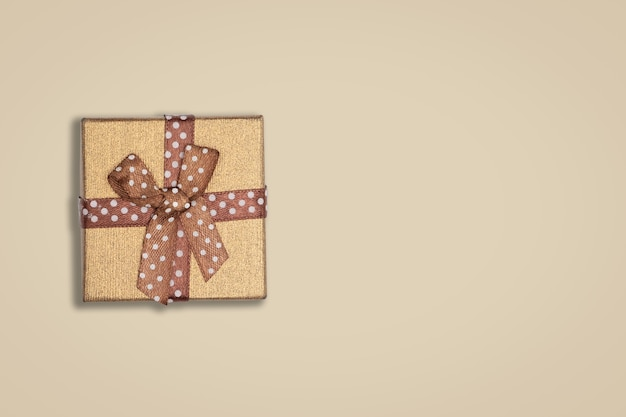 Top view of blown gift box on brown background