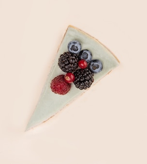 Top view of blue cheesecake with different berries