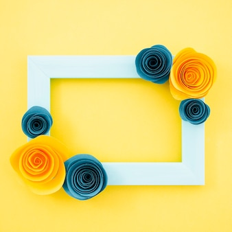 Top view blue floral frame on yellow background