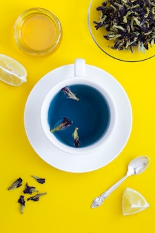 Top view of blue flower tea and dry flower petals