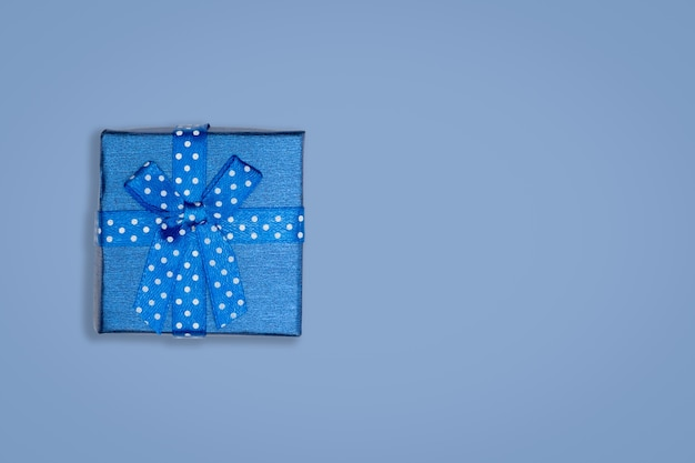 Top view of blue gift box on bluebackground