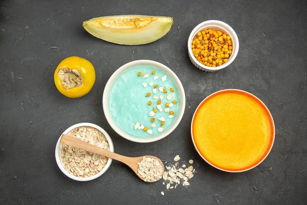Top view blue iced dessert with pumpkin soup on dark table milk cereal