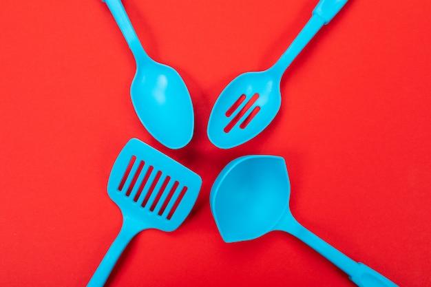 Top view of blue kitchen utensils