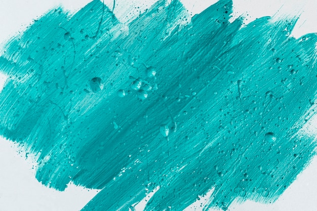 Top view of blue paint brush strokes on surface