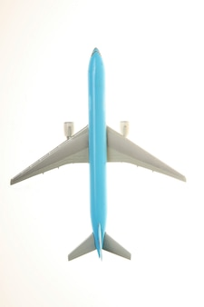 Top view of blue plane over white background