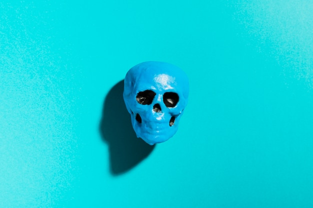 Top view blue skull on blue background