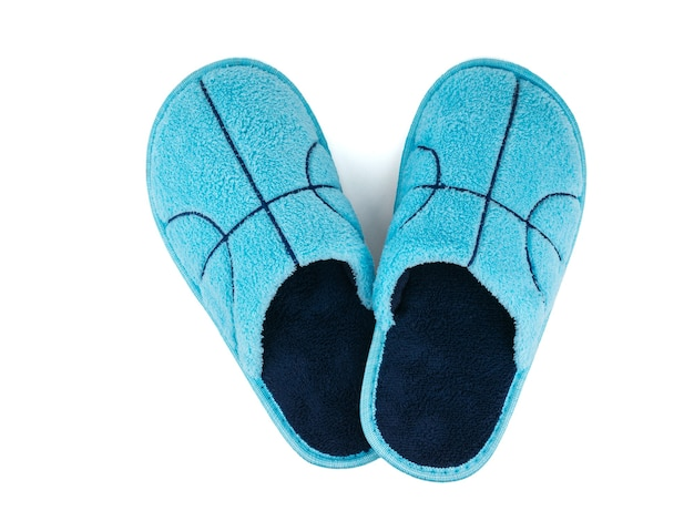 Top view of blue slippers isolated on white wall. comfortable home shoes. the view from the top.