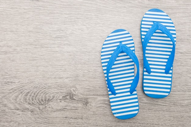 Top view of blue and white flip flops