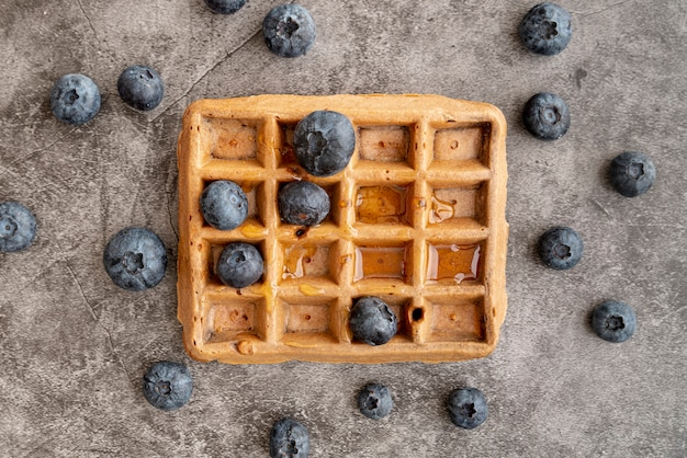 Top view of blueberries on top of waffle