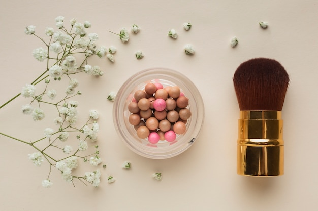 Top view blush and brush on table