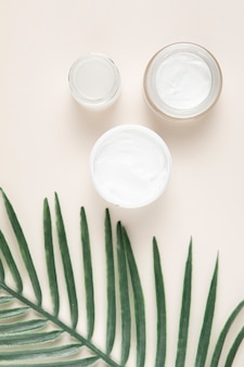 Top view of body butter cream on plain background