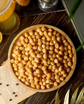 Top view of boiled chickpeas in bamboo bowl