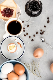 Top view boiled egg and coffee cup d