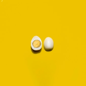 Top view boiled egg on yellow background