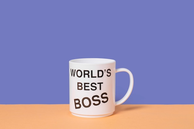 Top view boss's day arrangement with world's best boss cup