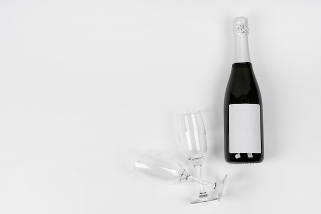 Top view bottle and glasses with copy-space