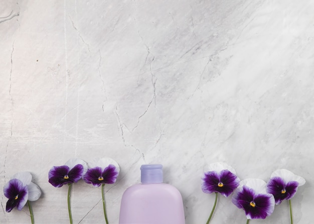 Top view of bottle on marble background with copy space