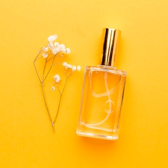 Top view bottle with perfume on the table
