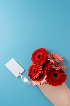 Top view of bouquet of flowers with blank card