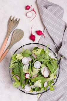 Top view of bowl of salad with radish