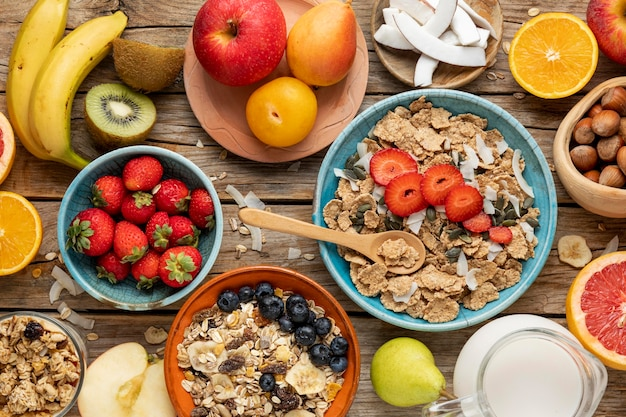 Top view of bowl with assortment of fruits and breakfast cereals