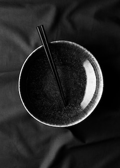 Top view of bowl with chopsticks