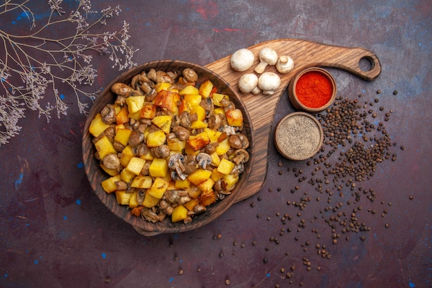 Top view a bowl with food a bowl with potatoes with mushrooms white mushrooms and colorful spices