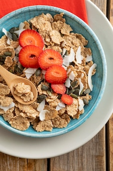 Top view of bowl with fruits and breakfast cereals