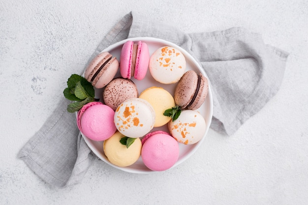 Top view of bowl with macarons and mint