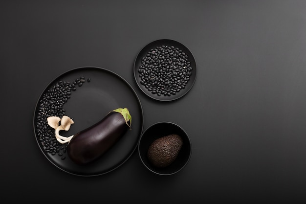 Top view bowls of delicious healthy eggplant and avocado
