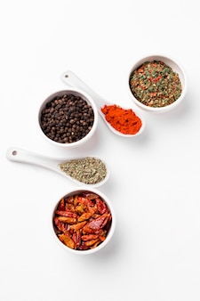 Top view bowls and spoons with spices