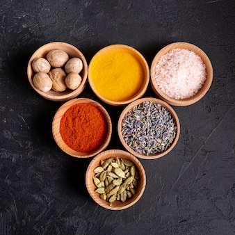 Top view of bowls with assortment of spices and salt