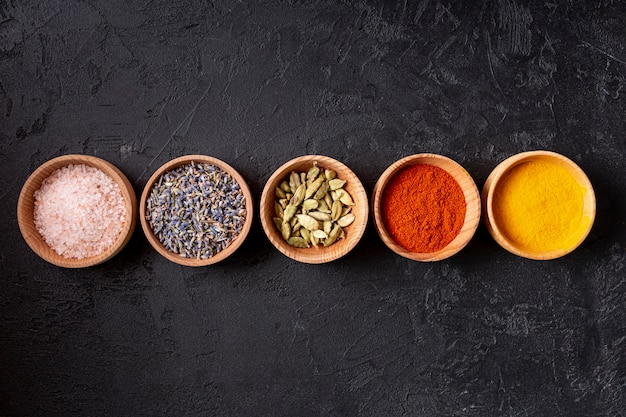 Top view of bowls with assortment of spices