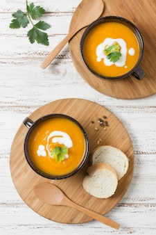 Top view bowls with pumpkin cream soup