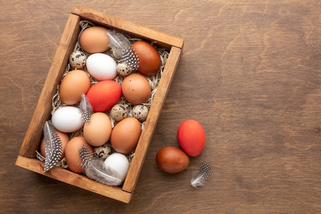 Top view of box with eggs for easter and copy space