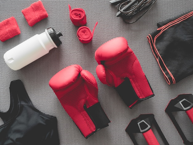 Top view of boxing gym  with boxing glove, gym outfit, skipping rope and accessories