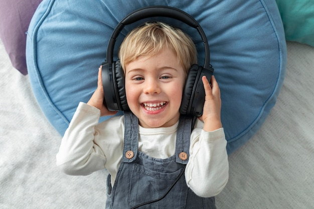 Top view boy listening music on headphones