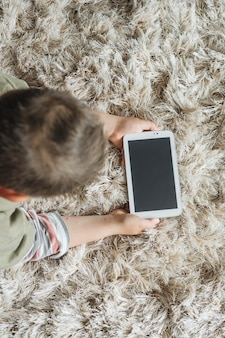 Top view of boy with smartphone template