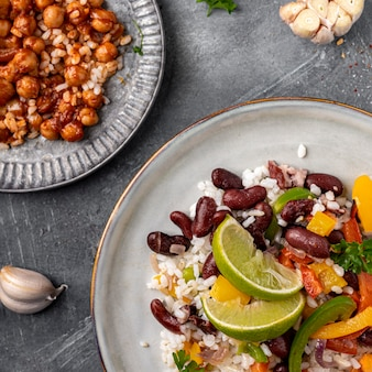 Top view brazilian food with beans and lime