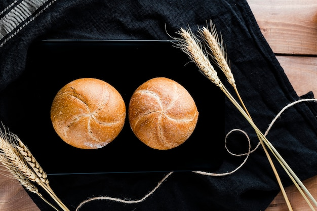 Top view of bread on cloth on wooden table