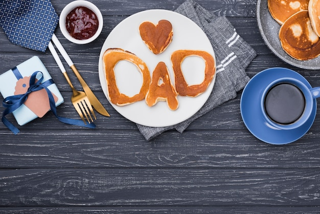 Top view bread letters for father's day copy space