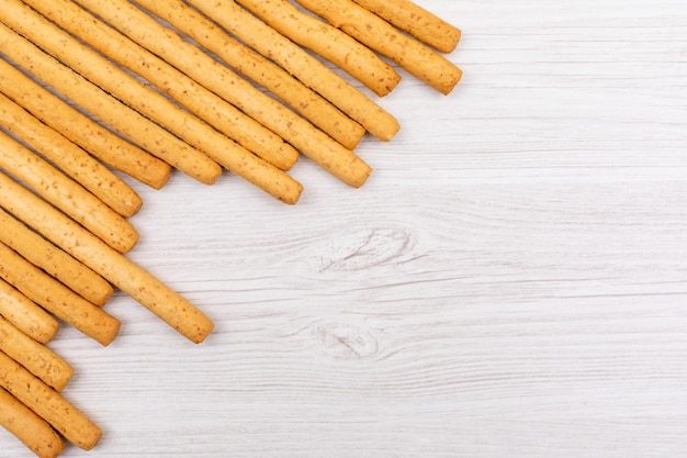 Top view bread sticks with copy space on white surface