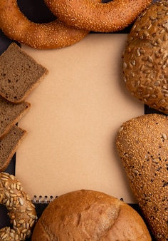 Top view of breads as cob bagel and rye bread slices with copy space