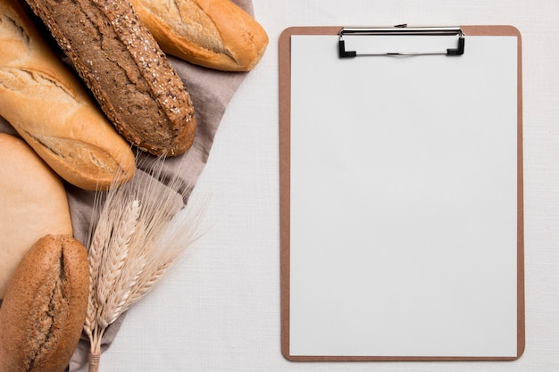 Top view breads mix with blank clipboard