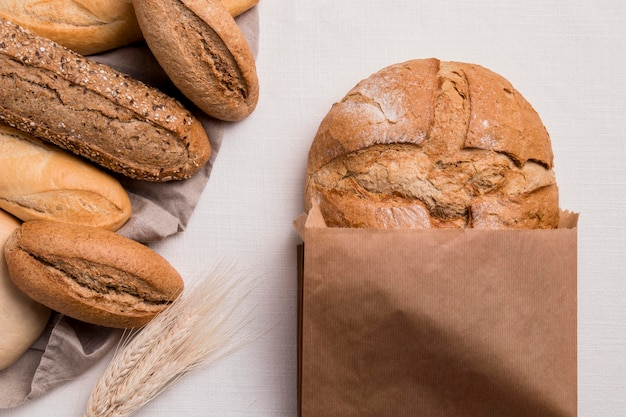 Top view breads mix with paper packaging and wheat