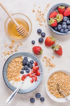 Top view breakfast bowl with honey and fruits