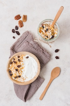 Top view breakfast bowl with oats and yogurt