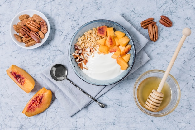 Top view breakfast bowl with yogurt and honey